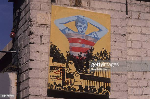 Sketch posted on the wall of the former US embassy in Tehran depicts the story of its occupation by militant students fifteen years earlier, on 4th...
