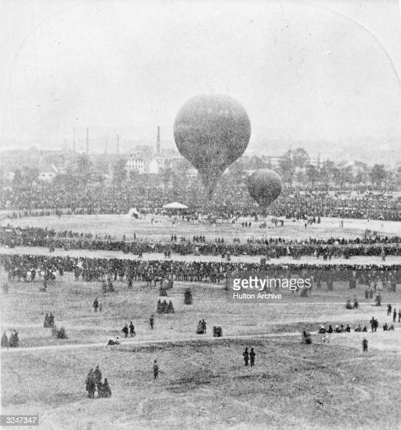 French caricaturist writer portrait photographer balloonist and showman Gaspard Felix Tournachon Nadar flies his giant balloon Le Geant from the...