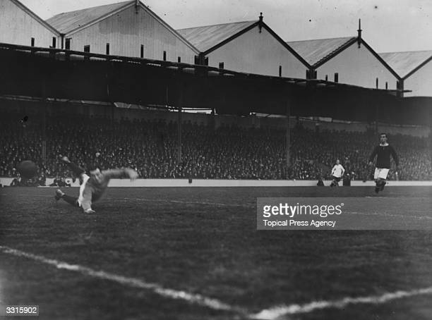 Woolwich Arsenal goalkeeper makes a save during their match against Bury at Highbury London