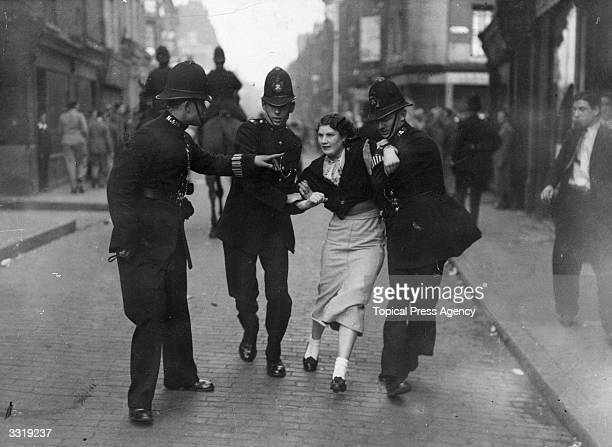 Policemen arresting a demonstrator when fascists and communists clashed during a march know as the Battle of Cable Street led by British fascist Sir...