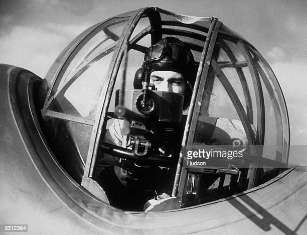 Colin Douglas a young RAF air gunner and former model gets his eye on the mark in an Avro Anson reconnaissance aircraft during training with 52...