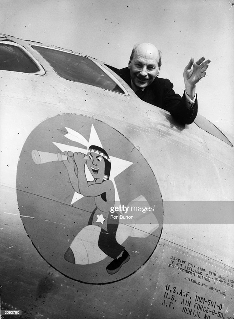 British prime minister Clement Attlee (1883 - 1967) waves from the cockpit of a US B 50 (Nifty 50) aircraft at Marham.