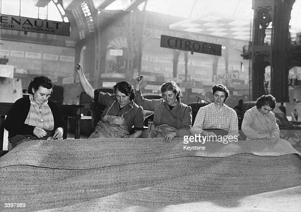 A group of women at the Grand Palace in Paris preparing for the opening of the Automobile Show