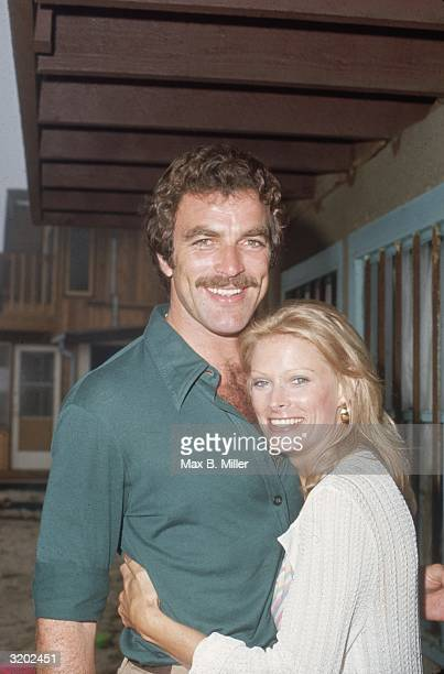American actor Tom Selleck and his wife Jacquelyn Ray hugging at actor Robert Colbert's birthday party at Colbert's home in Malibu California Selleck...