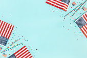 4th of July American Independence Day decorations on blue background. Flat lay, top view, copy space