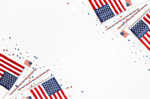 4th of July American Independence Day decorations on white background. Flat lay, top view, copy space 1157313676