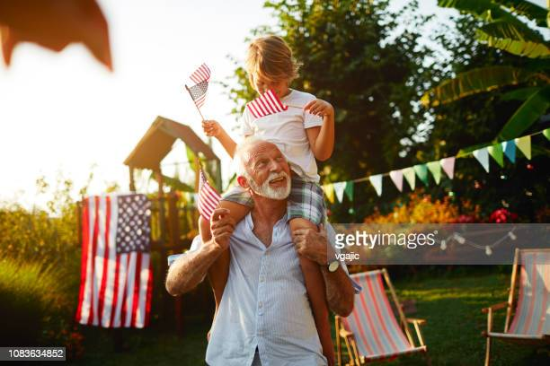 4th of july - grandfather and grandson - july stock pictures, royalty-free photos & images