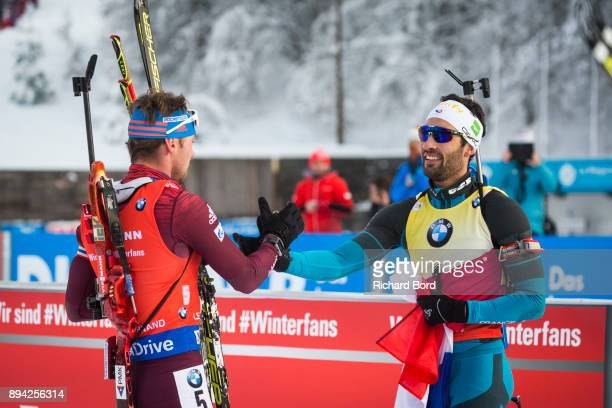 4th place Anton Shipulin of Russia and 1st place Martin Fourcade of France are seen in the finish area during the IBU Biathlon World Cup Men's Mass...