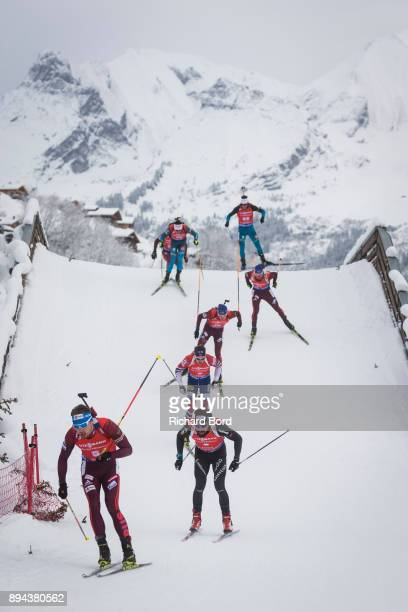 4th place Anton Shipulin of Russia and 5th place Arnd Weger of Switzerland compete during the IBU Biathlon World Cup Men's Mass Start on December 17...