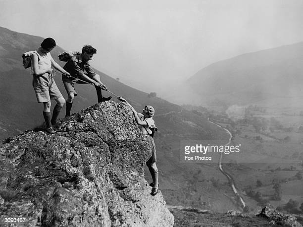 Mrs Smith and two friends reach the top of a bluff in North Wales during a mountain hike.