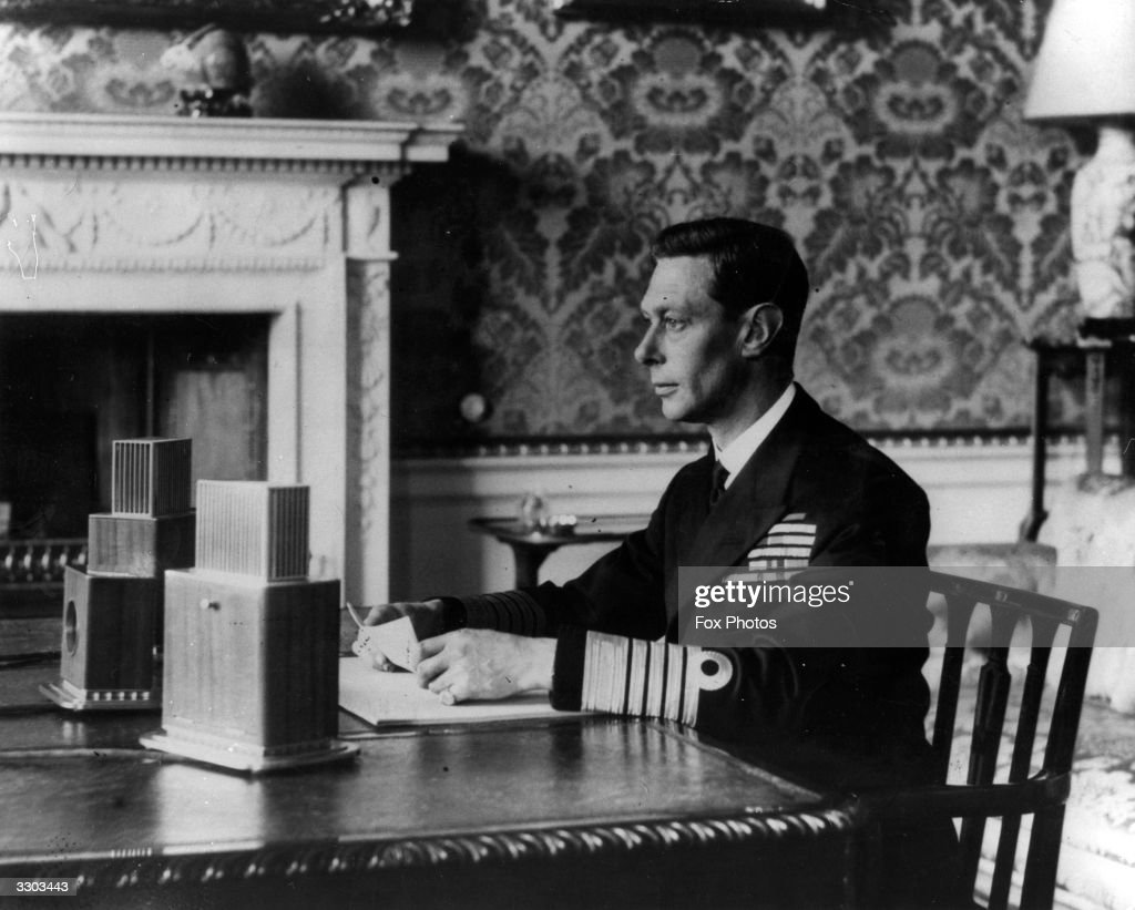 George VI (1895 - 1952), King of Great Britain (1936 - 1952) making his radio broadcast to the nation after the outbreak of World War II.