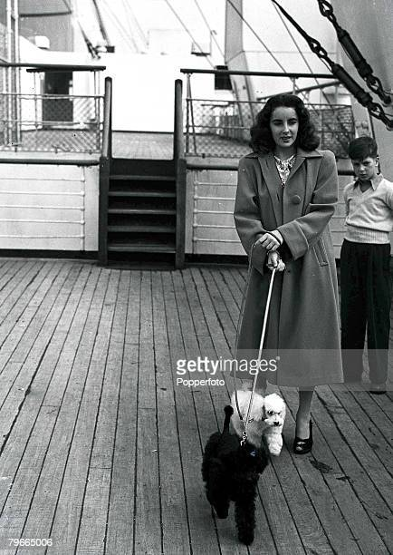 """4th September 1947, Film actress Elizabeth Taylor pictured aboard the liner """"Queen Mary"""" at Southampton, she is returning to the USA with two Poodles..."""