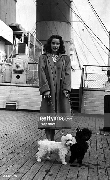 4th September 1947 Southampton England US actress Elizabeth Taylor is pictured on board the liner Queen Mary with her two French Poodle dogs ready to...