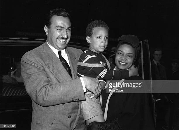American pianist and singer Hazel Scott with her husband Congressman Adam Clayton and their son on arrival in London where she will be performing at...