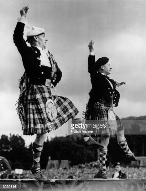 Couple of men doing a Highland dance at the Braemar Highland Games.