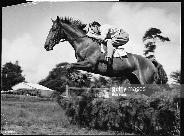 Champion National Hunt jockey Bryan Marshall takes three year old chestnut 'Sidown Hill' over a jump Marshall who was Champion National Hunt Rider in...