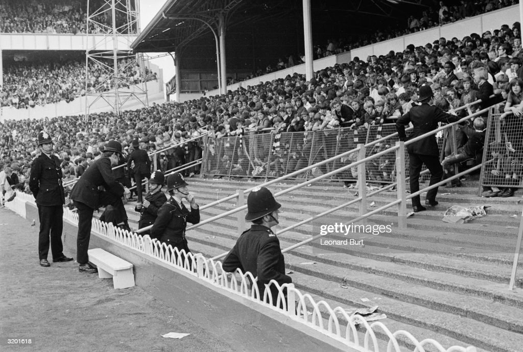 At a football match at White Hart Lane between Tottenham and Liverpool police take precautionary measures to prevent hooligan incidents which have marred recent games at the ground.