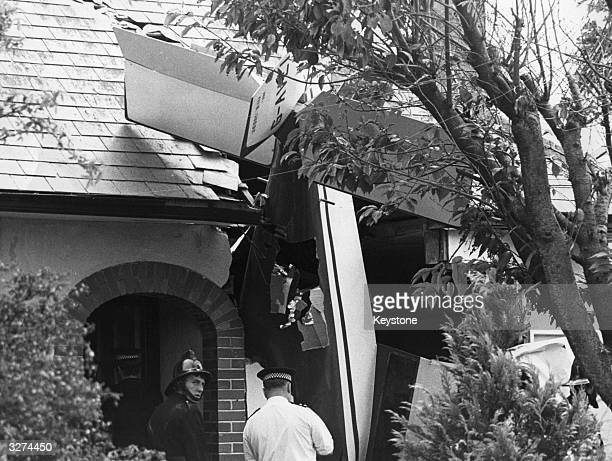 The scene after a light plane had fallen on a bungalow in Brixham Devon The occupant of the bungalow was unhurt The pilot his son and daughter were...