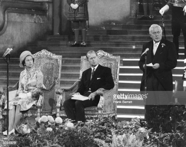 Queen Elizabeth II and Prince Philip listening to an address by the Prime Minister Harold Wilson at the opening of the 62nd InterParliamentary...