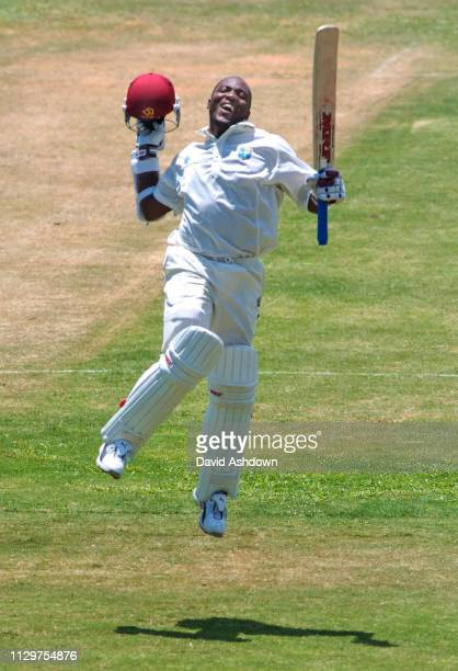 4th TEST 3rd DAY ENGLAND V WEST INDIES AT THE RECCREATION GROUND ANTIGUA BRIAN LARA JUMPS FOR JOY AFTER BREAKING THE WORLD RECORD TEST SCORE...