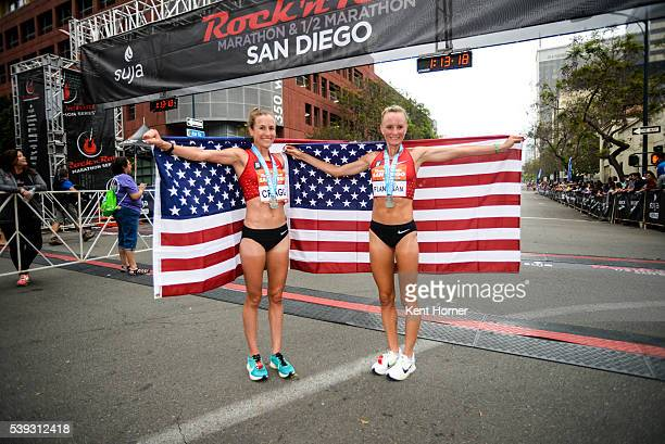 Time Olympian Shalane Flanagan, right, and 2-time Olympian Amy Cragg, left, pose with the Stars and Stripes flag after both set personal best times...