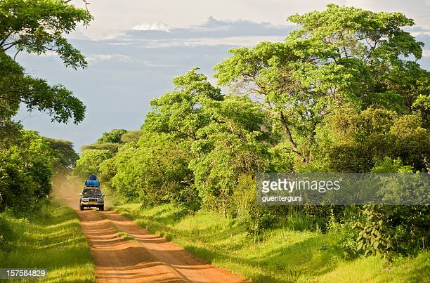 4wd car on an unpaved road in rural africa - democratic republic of the congo stock pictures, royalty-free photos & images