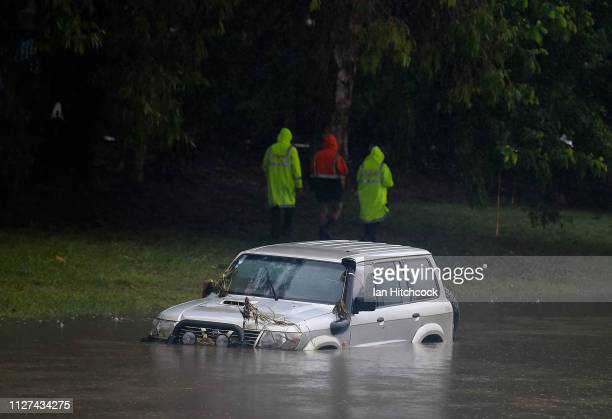 A 4wd vehicle is seen partially submerged in a drain after being swamped by flood waters on February 05 2019 in Townsville Australia Queensland...