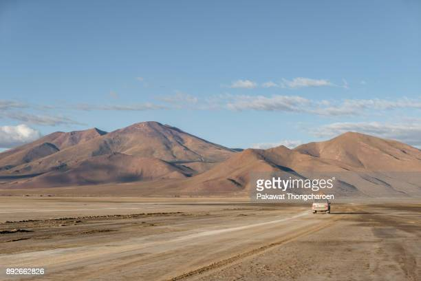4x4 driving on the road, salar de uyuni, altiplano, bolivia - altiplano stock pictures, royalty-free photos & images