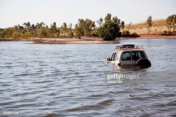 a 4x4 driving through deep water - flooding stock photos and pictures