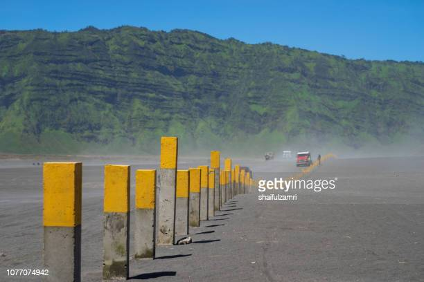 4x4 jeep service for tourist on desert at bromo mountain, mount bromo is one of the most visited tourist attractions in java, indonesia. - shaifulzamri stock pictures, royalty-free photos & images