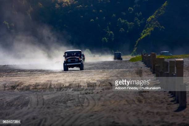 4x4 off road car driving inside bromo tengger semeru national park, indonesia - bromo crater stock pictures, royalty-free photos & images