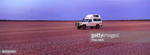 4x4 on mud plain, Sturt Desert, NSW, Australia