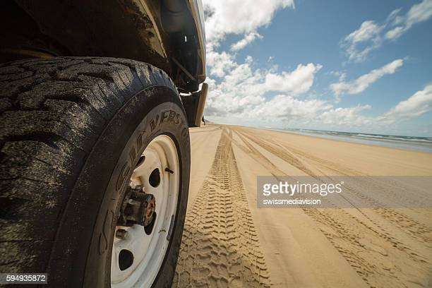4x4 wheel on sand in Fraser Island