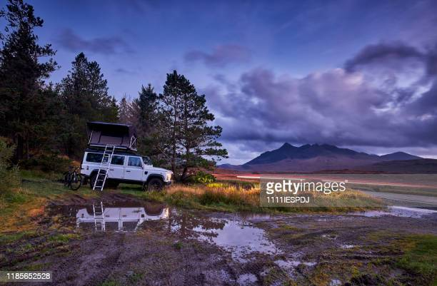4x4 with roof tent is wild camping. - land rover stock pictures, royalty-free photos & images