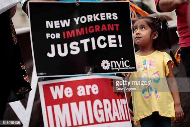4year oldJane Ojendiz daughter of Mexican immigrant Nieves Ojendiz looks up as her mother speaks to members and supporters of the New York...