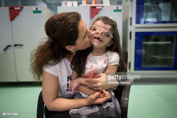 4yearold Elif Ada who was born with a visual impairment due to a genetic disease poses for a photo with her newly produced eyeglass using 3D printing...
