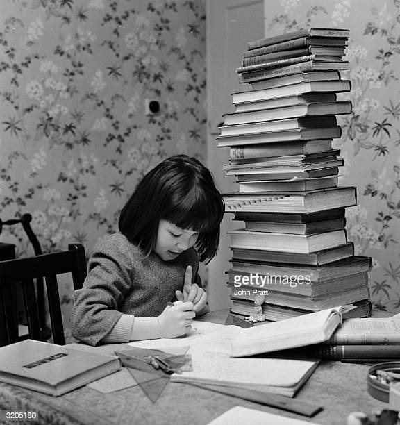 4yearold Maybelle Thompson studying hard surrounded by piles of reference books Her exceptional proficiency at mathematics has convinced the...