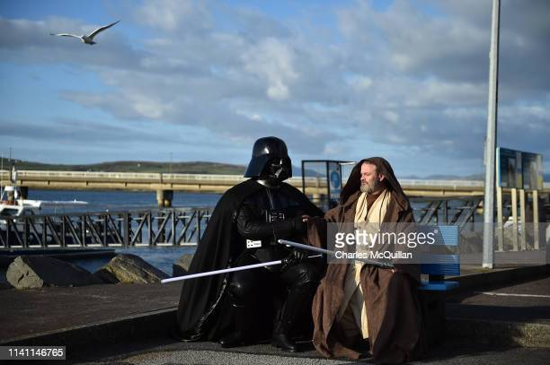 501st Garrison Ireland Leigon members Alan Bell and John O'Dwyer playing the characters Obi Wan Kenobi and Darth Vader sit on a bench on May 4, 2019...