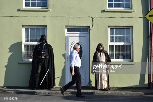 501st Garrison Ireland Leigon members Alan Bell and John O'Dwyer playing the characters Obi Wan Kenobi and Darth Vader stand in the village main...