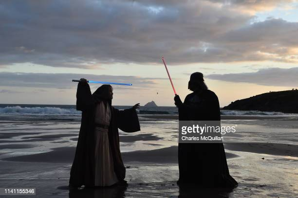 501st Garrison Ireland Leigon members Alan Bell and John O'Dwyer playing the characters Obi Wan Kenobi and Darth Vader cross swords against the...