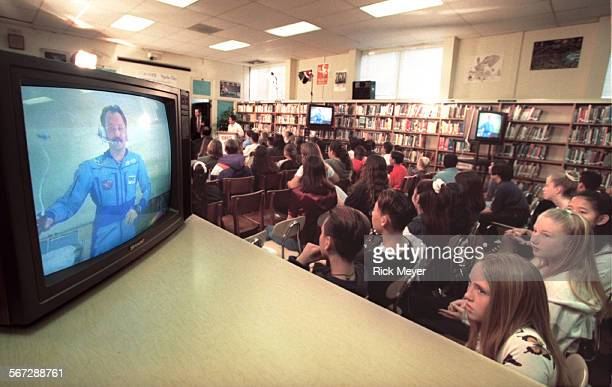 RM/b Students from the 8th grade class at Bellflower High School watch the TV feed from the Mir Space Station showing flight engineer Yuri Usachev...