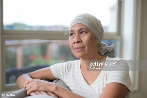 50ish Hawaiian woman wearing headwrap on couch