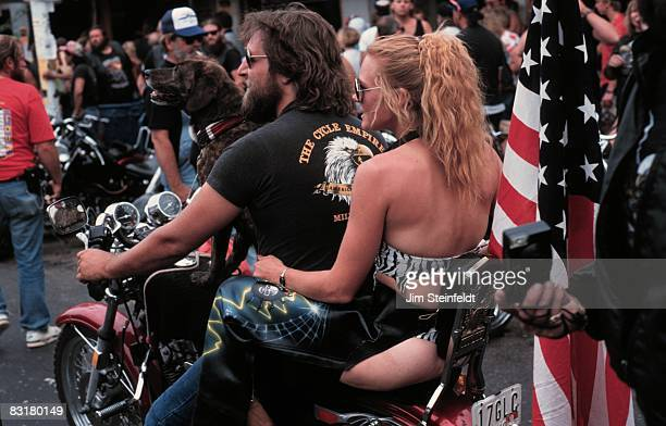 50th Anniversary of the World Famous Sturgis Motorcycle Rally Man woman and dog on a Harley Davidson flying the American flag in Sturgis South Dakota...
