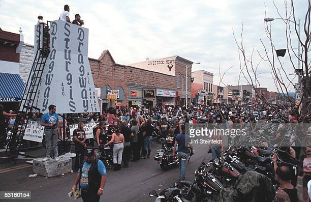 50th Anniversary of the World Famous Sturgis Motorcycle Rally Wide angle view of the Sturgis Dragway with rows of mortorcycles and lots of bikers...