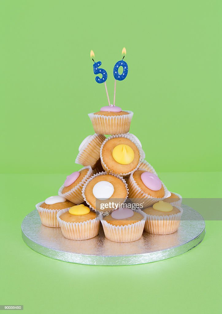 50th Birthday Candles On Pile Of Fairy Cakes Stock Foto