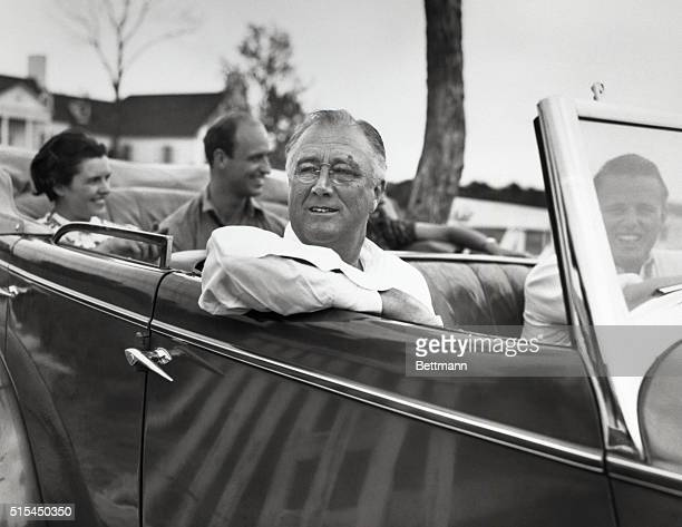 Fort Worth, Texas- President Roosevelt leaves the home of his son Elliot for a drive. In the rear of the car are Mrs. Elliot Roosevelt; James...