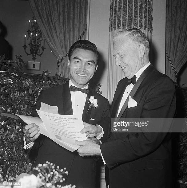 5/10/1966New York NY United Press International photographer Kyoichi Sawada 1936 1970 accepts a Pulitzer Prize Award from Maurice T Moore Chairman of...