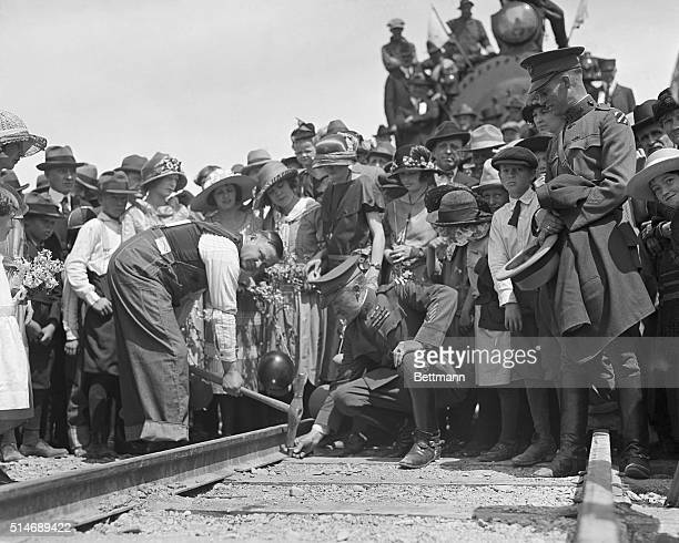 5/11/1923The Governor Aided by General MacAlexander shows a practiced hand in driving down the final spike of pure western gold