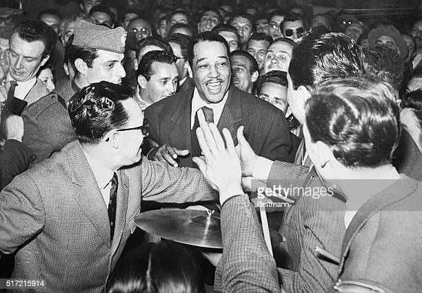 5/11/1950Milan Italy American band leader and composer Duke Ellington finds himself surrounded by jazz fans upon his arrival at Milan Railway Station...