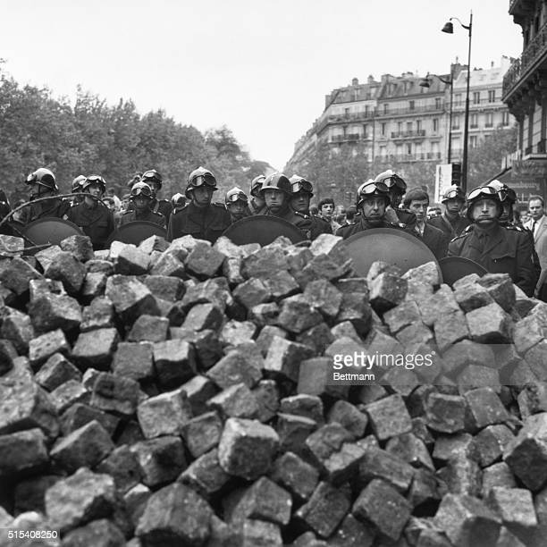 5/11/1968Paris France Even in the morning there were still student rioting in the Latin Quarter Riot police wait behind stone barricade
